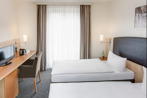 InterCityHotel Wien - Viena - Quarto